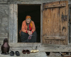 Lady Knitting in Doorway by robert Millin - Photography Club