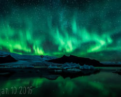 Icelandic Aurora Over Fjallsarlon by Damo Black