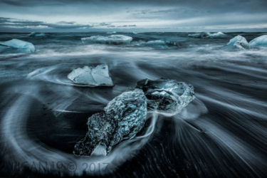 Glacial Ice On Breidamerkursandur by Damian Black